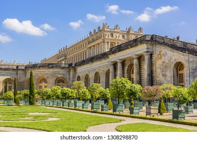 VERSAILLES, PARIS, FRANCE - MAY 18, 2014: Beautiful Orangerie Parterre in famous Versailles palace: palm trees, oleanders, pomegranate, eugenics and orange trees.
