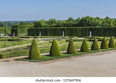 VERSAILLES, PARIS, FRANCE - MAY 18, 2014: Picturesque Gardens of famous Versailles Palace. The Palace of Versailles was a royal chateau.