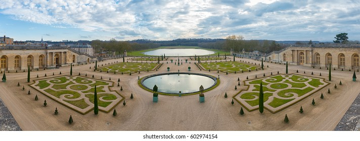 VERSAILLES,FRANCE - FEBRUARY 15 2017 : Symmetric french gardens of the Orangerie of Versailles palace in France, symbol of king Louis XIV power, panoramic view.