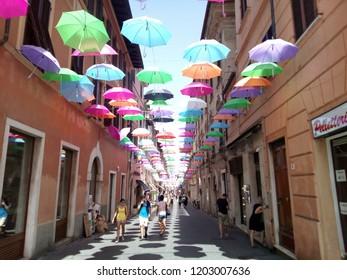 Versilia, Tuscany, Italy - August 2017. Decorative umbrellas in a street of Versilia.