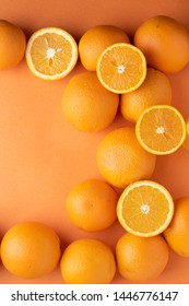 vertiacal photo of many oranges and kids hands, creative food idea for designer