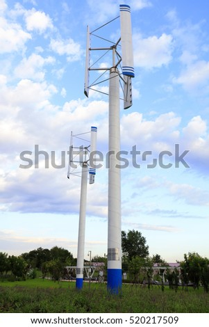 Vertical Axis Wind Turbine Under Blue Stock Photo (Edit Now