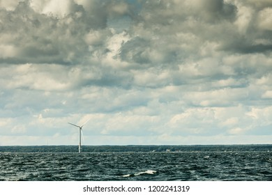 Vertical axis wind turbines generator farm for renewable sustainable and alternative energy production along coast baltic sea near Denmark. Eco power, ecology.