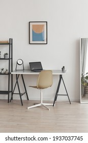 Vertical background background of minimal home office workplace in modern apartment decorated by abstract art, copy space