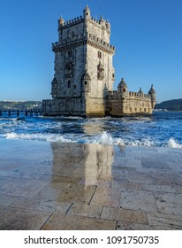 Vertical Belem tower and reflection on high tide