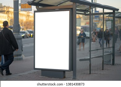 Vertical billboard lightbox in the city advertising in the bus shelter. for placing the MOCKUP advertisement with people in the background