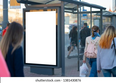 Vertical billboard lightbox in the city. for placing the MOCKUP advertisement with people in the background advertising in the bus shelter