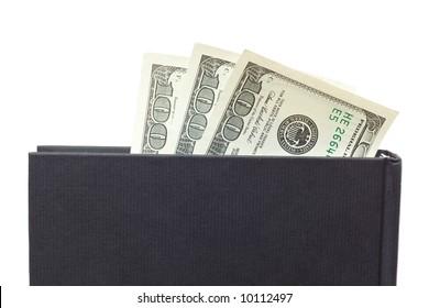 vertical black book and dollars