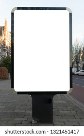 Vertical blank glowing billboard on the city street