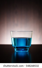 Vertical blue drink in a glass