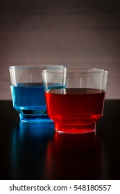 Vertical blue and red drink in a glass focused on the blue