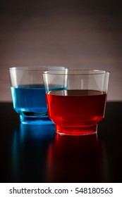 Vertical blue and red drink in a glass focused on the red