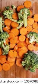 vertical brocolli carrots wood cutting board