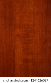 Vertical cherry wood pattern with a cross gain effect.