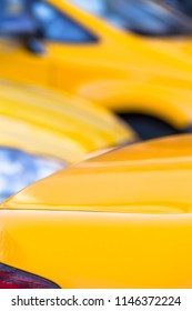 Vertical close up detail of yellow taxi cars background (copy space)
