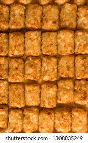 A vertical close up shot of tater tot hot dish, shot from above and filling the frame.