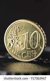 Vertical close-up image of a ten Euro cent coin.