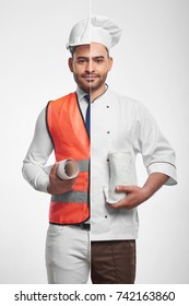 Vertical combined studio portrait of an attractive young bearded man dressed as a professional architect in safety vest and hardhat and a chef cook eating food healthy nutrition building.