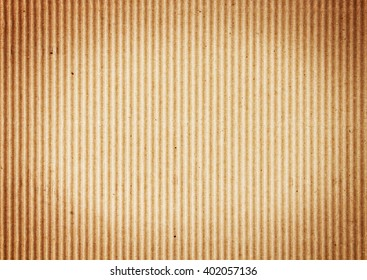 Vertical corrugated cardboard. Can be used as background or for a variety of designs.