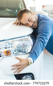 Vertical cropped shot of a happy mature man smiling hugging his new car looking excited consumer buyer shipping purchasing consumption leasing travelling driving insurance rental service