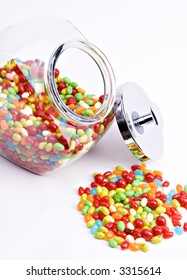 vertical cropped view of open jar of jelly beans with silver lid