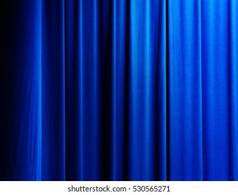 vertical drapes of a curtain with blue color