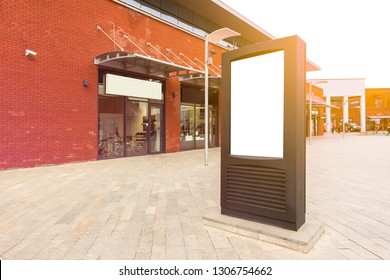 Vertical empty billboard placeholder template on the street, day light