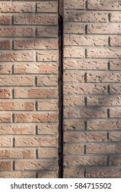 Vertical expansion joint makes allowance for thermal expansion of the parts joined without fracture or fissure. Dilatation joint between two blocks of buildings