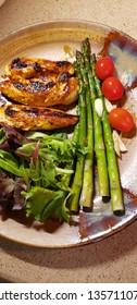vertical food chicken asparagus tomato salad greens