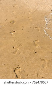 Vertical Footprints on the sand beach
