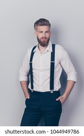 Vertical front view portrait of chic posh stylish confident focused concentrated stunning rich wealthy macho with blonde hair keeping hands in pockets sexy look isolated on gray background