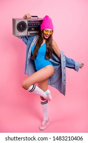 Vertical full length body size view of her she nice attractive glamorous graceful thin slender cheerful straight-haired girl posing having fun pleasure carrying boombox isolated over pink background