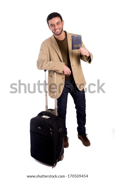 vertical full length portrait of a man smiling leaning on a suitcase holding a passport in casual clothes on a white background