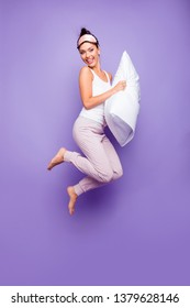Vertical full length side profile body size photo beautiful she her lady jump hold arms hands pillow naked nude feet foot satisfied wear sleeping mask pants tank-top isolated violet purple background