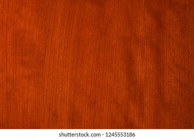Vertical grain cherry wood with medium red finish.