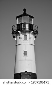 A vertical grayscale shot of a decorative lighthouse