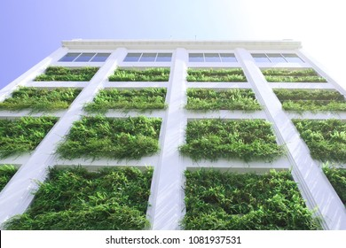 vertical green garden facade wall skin of architectural high rise building with tinted glazing which saving energy by passive cooling from the plants