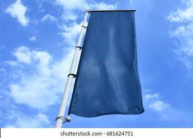 Vertical hanging blue fabric banner flag