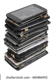 Vertical heap of the  broken  phones closeup. Mass production devices are prepared for industrial utilization. Isolated with patch selective focus studio shot