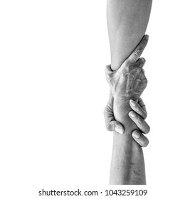 Vertical help hands holding together representing friendship, partnership, help and hope, donation, assistance. Dramatic monochrome black and white effect.