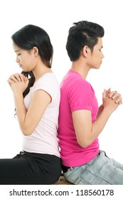 Vertical image of a couple praying for their love and happiness