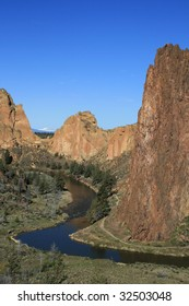 vertical image of the Crooked River curving past the cliffs of Smith Rock State Park