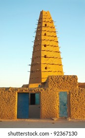 A vertical image of the front of the mud mosque in Agadez