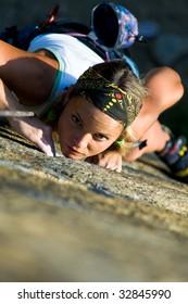 Vertical image of girl training rock-climbing