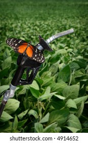 vertical image of orange butterfly on gasoline nozzle.