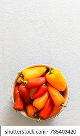 Vertical image of peppers against a white background.