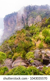 Vertical image of the Pillar rocks in Kodaikanal partially covered under clouds