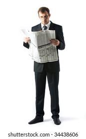 Vertical image of successful boss reading newspaper in studio