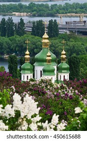 vertical image with Vydubychi Monastery among blossoming lilac in Kiev, Ukraine