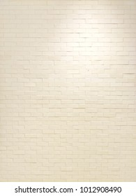 Vertical image of white brick wall texture for vintage or earthtone background concept